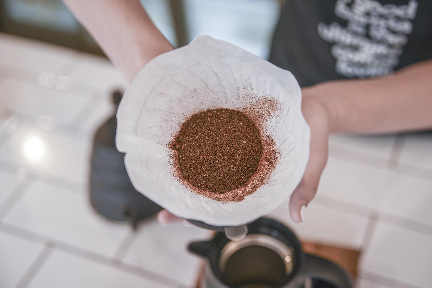 Coffee in a chemex filter from a manual coffee grinder