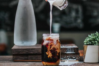 cold brew pouring into mason jar